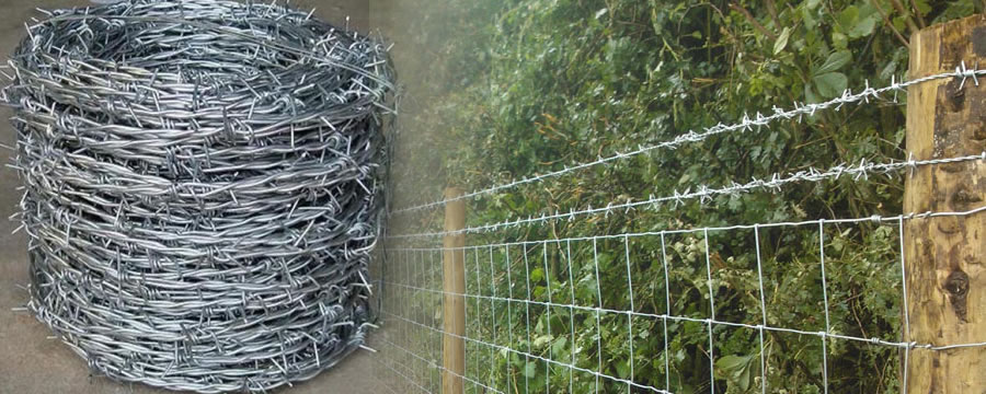 Hinge Joint Woven Wire Netting Installed with Top Lines of Hot Dip Galvanised Barbed Wire